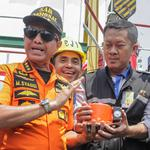 Chief of National Search and Rescue Agency Muhammad Syaugi (L) shows part of the black box of  Lion Air's flight JT610 airplane, on Baruna Jaya ship, in the north sea of Karawang