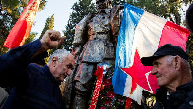 People crowd for a picture at the monument of late Yugoslav leader Josip Broz Tito after unveiling ceremony in Podgorica