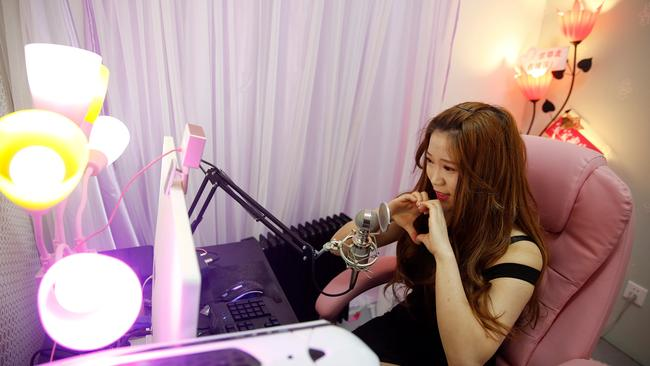 A girl broadcasts at live streaming talent agency Three Minute TV in Beijing