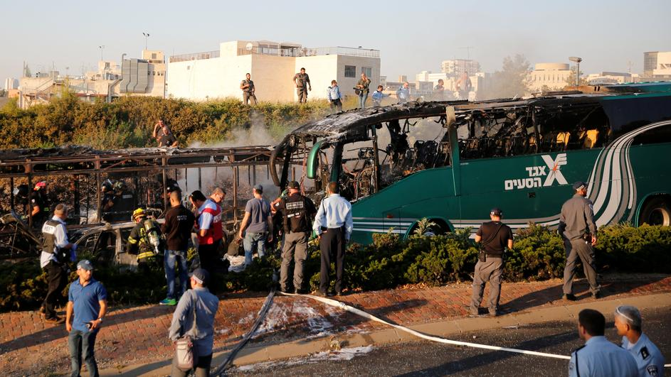 Emergency workers search the scene after a blast on a bus in Jerusalem