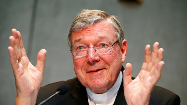 FILE PHOTO - Cardinal George Pell gestures as he talks during a news conference for the presentation of new president of Vatican Bank IOR, at the Vatican