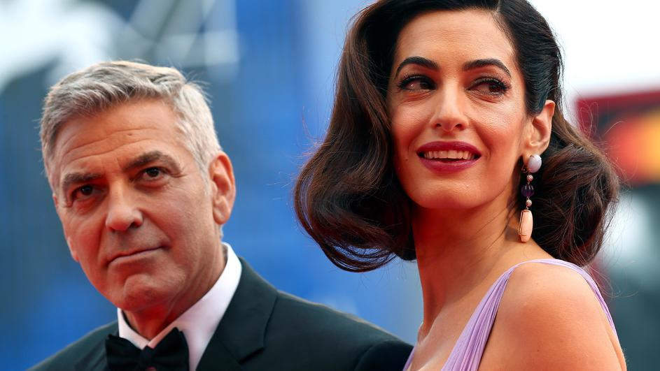 "Actor and director George Clooney and his wife Amal pose during a red carpet event for the movie ""Suburbicon"" at the 74th Venice Film Festival in Venice, Italy"