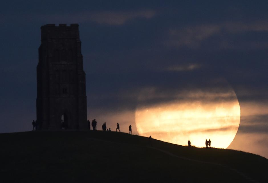 "The moon rises near Glastonbury Tor a day before the ""supermoon"" spectacle, in Glastonbury 