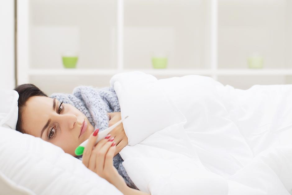 Fever And Cold. Portrait Of Beautiful Woman Caught Flu, Having H | Autor: Dreamstime