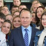 Russian President Vladimir Putin meets with volunteers at his campaign office for the upcoming presidential election in Moscow