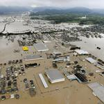 An aerial view shows submerged houses and facilities at a flooded area in Kurashiki