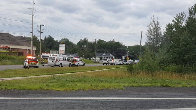 Emergency vehicles are seen at the Brookside Drive area in Fredericton
