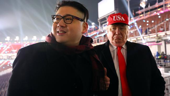 People dressed-up as U.S. President Donald Trump and North Korean leader Kim Jong Un attend the Winter Olympics opening ceremony in Pyeongchang
