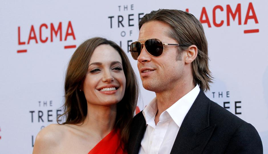 "FILE PHOTO: Pitt and Jolie pose at the premiere of ""The Tree of Life"" at LACMA in Los Angeles 