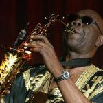 FILE PHOTO: Camoroonese musician Manu Dibango plays his saxaphone during French designer Sorbier's Spring/Summer..