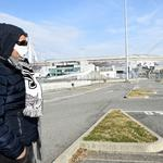 FILE PHOTO: A man wearing a face mask is seen outside the Allianz Stadium in Turin