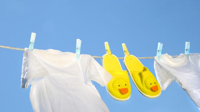 White t-shirts and slippers on the clothesline