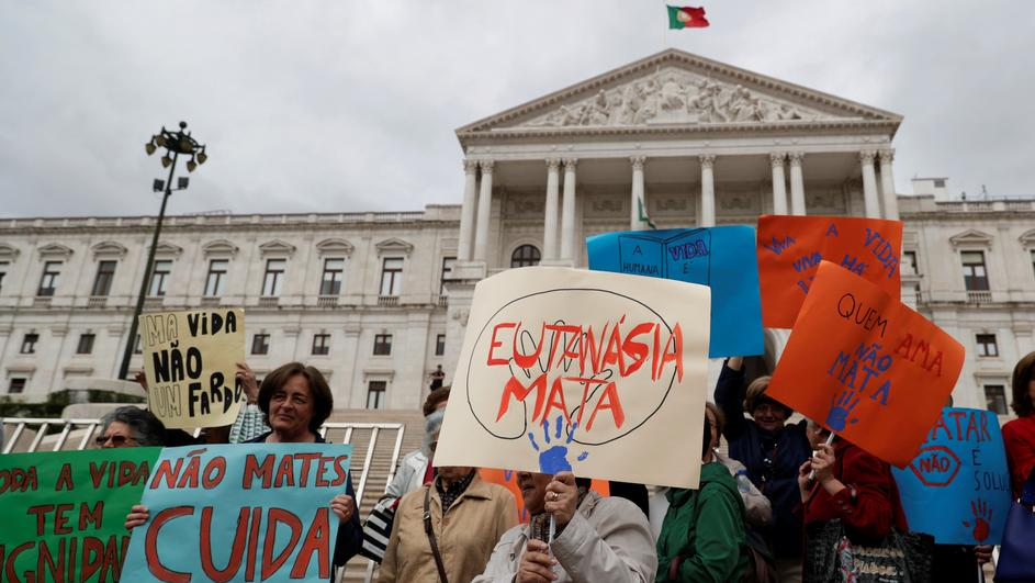 Demonstrators attend a protest against euthanasia in front off the parliament in Lisbon