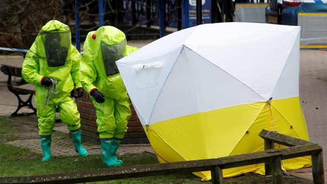 FILE PHOTO: The forensic tent, covering the bench where Sergei Skripal and his daughter Yulia were found, is repositioned by officials in protective suits in the centre of Salisbury