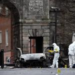 Forensic officers arrive at the scene of a suspected car bomb in Londonderry