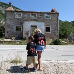 Kids are seen in front of Luka Modric's birth house in Modrici village