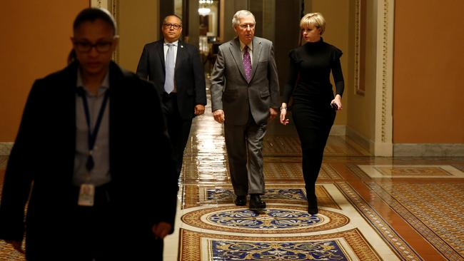 Senate Majority Leader Mitch McConnell (R-KY) walks to the Senate floor before a vote to end a government shutdown in Washington
