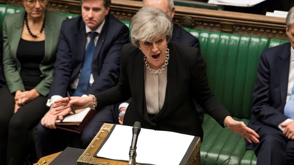 FILE PHOTO: Britain's Prime Minister Theresa May speaks during a debate on her Brexit 'plan B' in Parliament