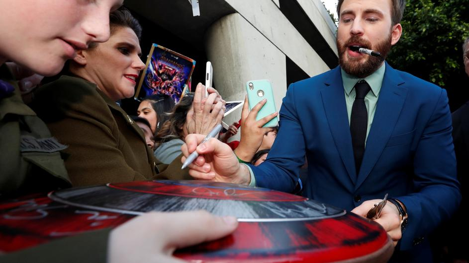 "Cast member Chris Evans signs autographs for fans on the red carpet at the world premiere of the film ""The Avengers: Endgame"" in Los Angeles"