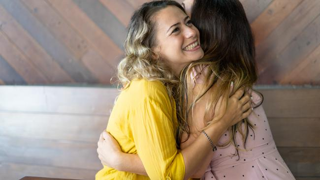 Pretty blond woman excited to see her long-distance friend