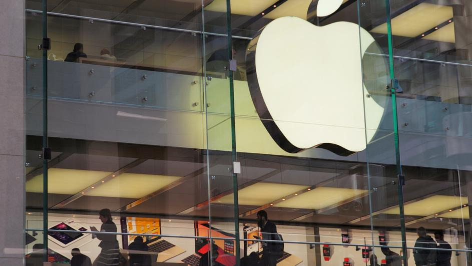 Customers and employees are shown through Apple's Australian flagship store in Sydney