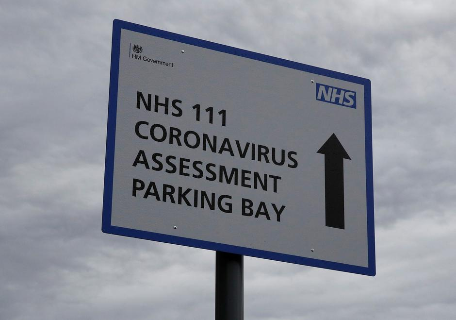 Signage directing patients towards a Coronavirus assessment bay is seen outside Whiston Hospital in Liverpool | Autor: PHIL NOBLE