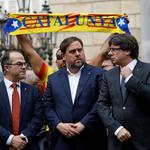 Catalan President Carles Puigdemont and other dignitaries stand in Plaza Sant Jaume in Barcelona