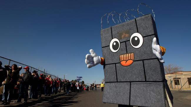 A Trump supporter dressed up as a border wall is seen as others queue to enter El Paso County Coliseum for a rally by U.S. President Trump in El Paso