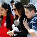 Students and parents from Marjory Stoneman Douglas High School attend a memorial following a school shooting incident in Parkland