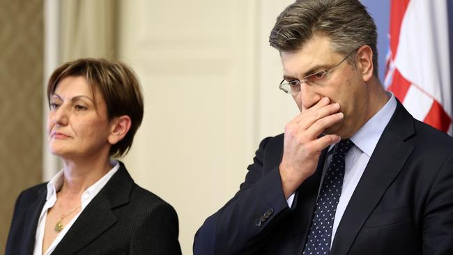 Croatia's Prime Minister Andrej Plenkovic and Martina Dalic, Minister of Economy, attend a news conference in a government building in Zagreb
