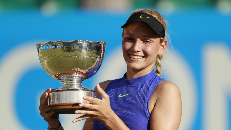 Croatia's Donna Vekic celebrates winning the final with the trophy