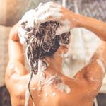 Beautiful woman taking shower