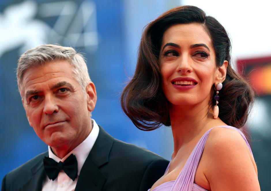 "Actor and director George Clooney and his wife Amal pose during a red carpet event for the movie ""Suburbicon"" at the 74th Venice Film Festival in Venice, Italy 