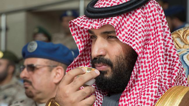 Saudi Arabia's Crown Prince Mohammed bin Salman drinks coffee during the graduation ceremony of the 93rd batch of the cadets of King Faisal Air Academy, in Riyadh