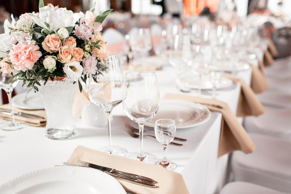 Tables set for an event party or wedding reception. luxury elegant table setting dinner in a restaurant. glasses and dishes. | Autor: Dreamstime