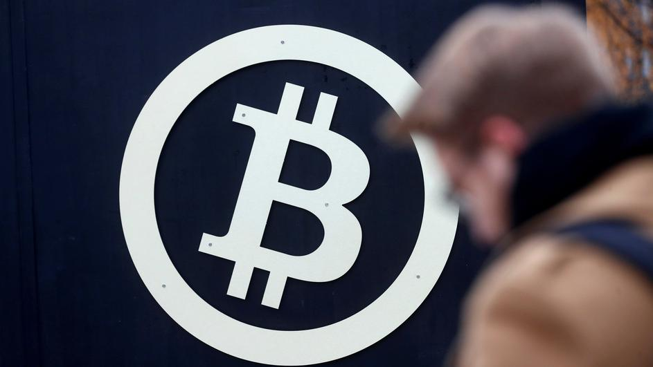 FILE PHOTO: A bitcoin sign is seen during Riga Comm 2017 fair in Riga