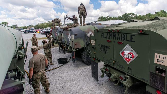 South Carolina National Guard soldiers transfer bulk diesel fuel into fuel tanker trucks for distribution in advance of Hurricane Florence