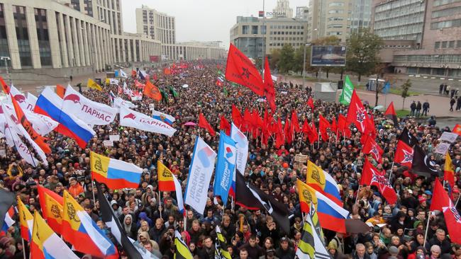 People attend a rally to demand the release of jailed protesters in Moscow