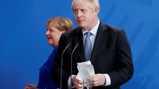 FILE PHOTO: German Chancellor Merkel meets Britain's Prime Minister Johnson at the Chancellery in Berlin