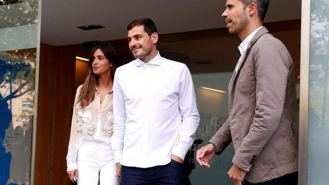 Spanish soccer player Iker Casillas leaves CUF Porto hospital accompanied by his wife Sara Carbonero in Porto