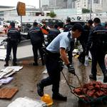 Police officers display objects used during a demonstration outside the Legislative complex in Hong Kong