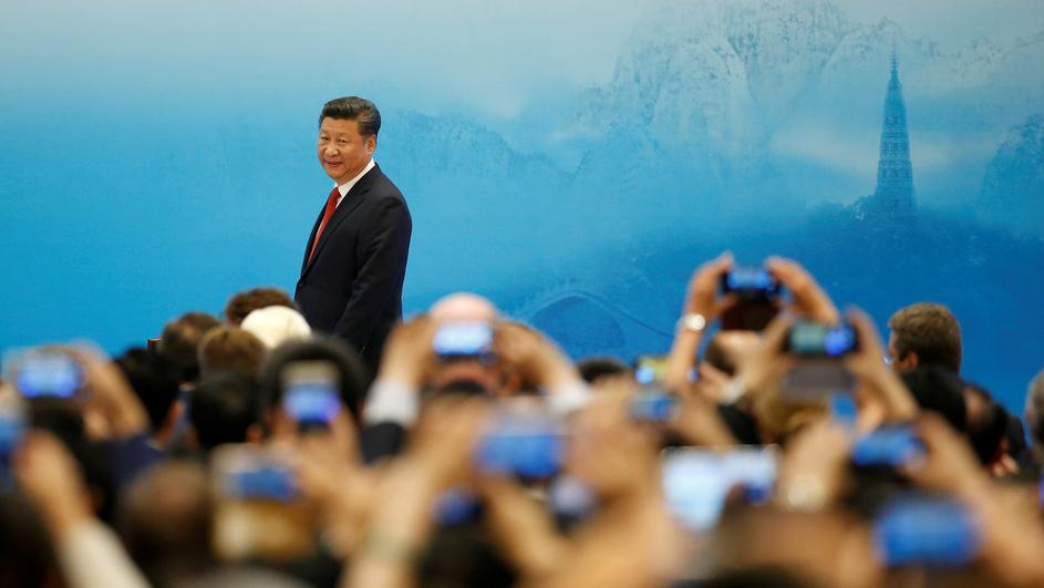 FILE PHOTO: China's President Xi Jinping arrives for the opening ceremony of B20 Summit ahead of G20 Summit, in Hangzhou