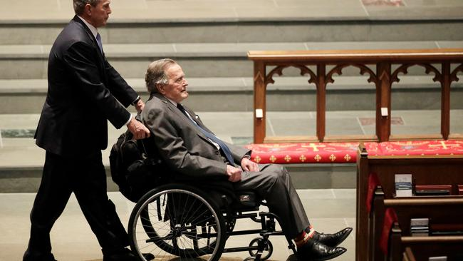 Former Presidents George W. Bush, and George H.W. Bush arrive at St. Martin's Episcopal Church for funeral services for former first lady Barbara Bush in Houston