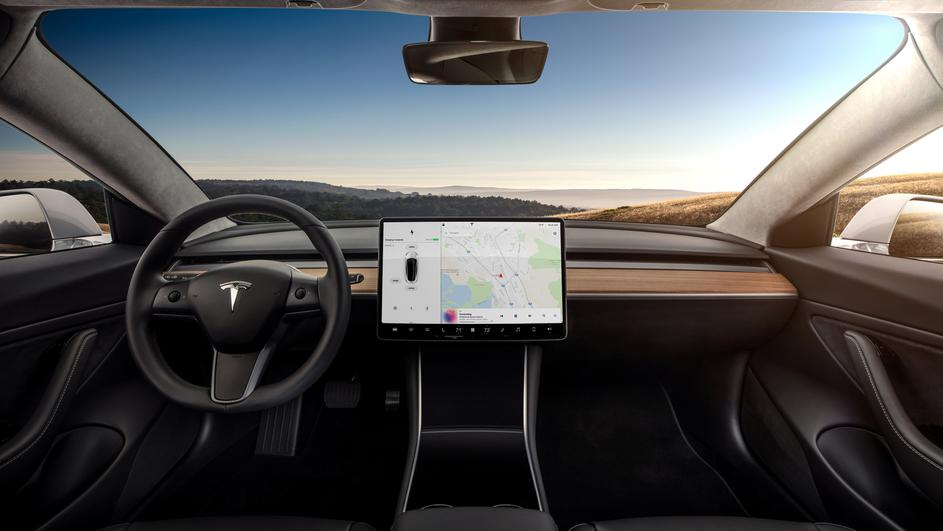 The interior of the Tesla Model 3 sedan is seen in this undated handout image as the car company handed over its first 30 Model 3 vehicles to employee buyers at the company's Fremont facility