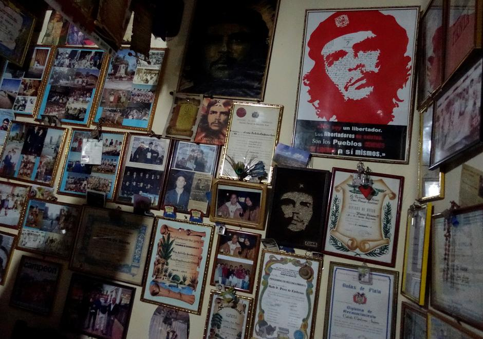 "A wall decorated with images of Ernesto ""Che"" Guevara is seen at the home of a resident in Vallegrande 