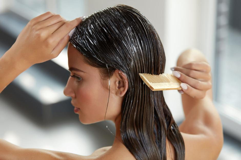 Beautiful Woman Putting Mask On Long Wet Hair. Hairbrushing | Autor: Ihor Pukhnatyy