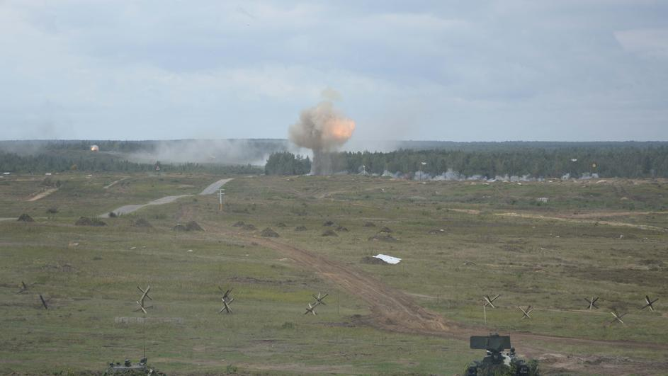 Armoured vehicles fire during the Zapad-2017 war games in Belarus