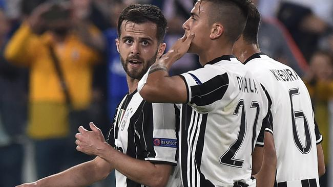 Juventus' Paulo Dybala celebrates scoring their second goal with Miralem Pjanic