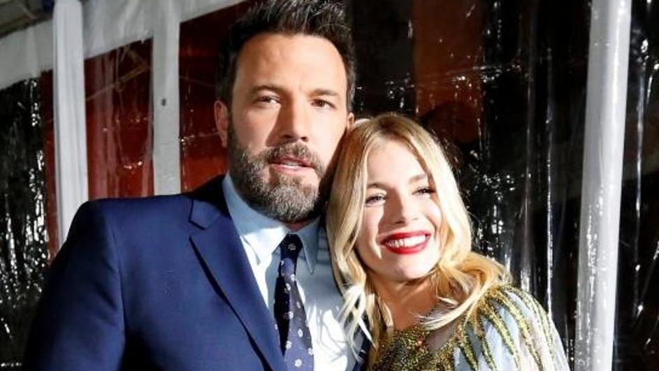 Director and cast member Affleck poses with cast member Miller at the premiere of