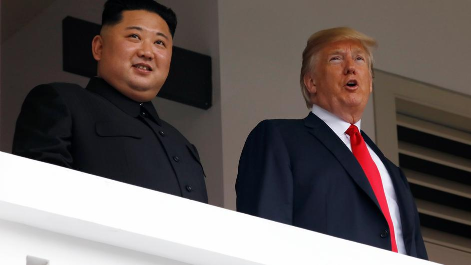 U.S. President Donald Trump and North Korean leader Kim Jong Un react at the Capella Hotel on Sentosa island in Singapore